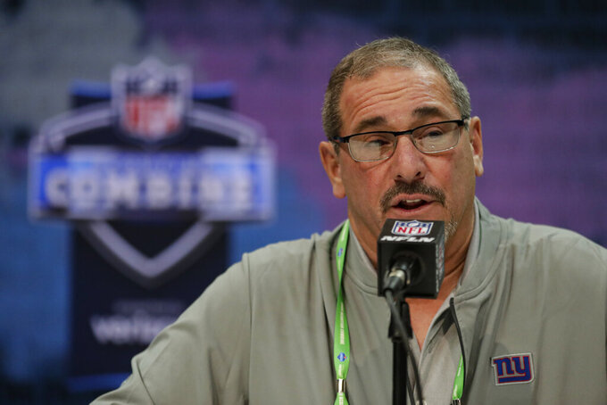FILE - In this Feb. 25, 2020, file photo, New York Giants senior vice president and general manager Dave Gettleman speaks during a press conference at the NFL football scouting combine in Indianapolis. Gettleman made three draft-day deals in which he moved up and down, found promising players at need positions and picked up three extra choices for next year's event that supposed to deeper in talent (AP Photo/Michael Conroy, File)