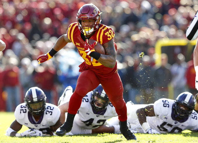 FILE - In this Oct. 28, 2017, file photo, Iowa State running back David Montgomery runs from TCU defenders Travin Howard (32), Ty Summers (42) and Chris Bradley (56) during the first half of an NCAA college football game, in Ames, Iowa. Iowa State takes on South Dakota State on Saturday, Sept. 1, 2018, in Ames, Iowa. (AP Photo/Charlie Neibergall, File)