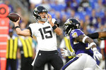 Jacksonville Jaguars quarterback Gardner Minshew looks to pass against the Baltimore Ravens during the first half of an NFL football preseason game Thursday, Aug. 8, 2019, in Baltimore. (AP Photo/Nick Wass)