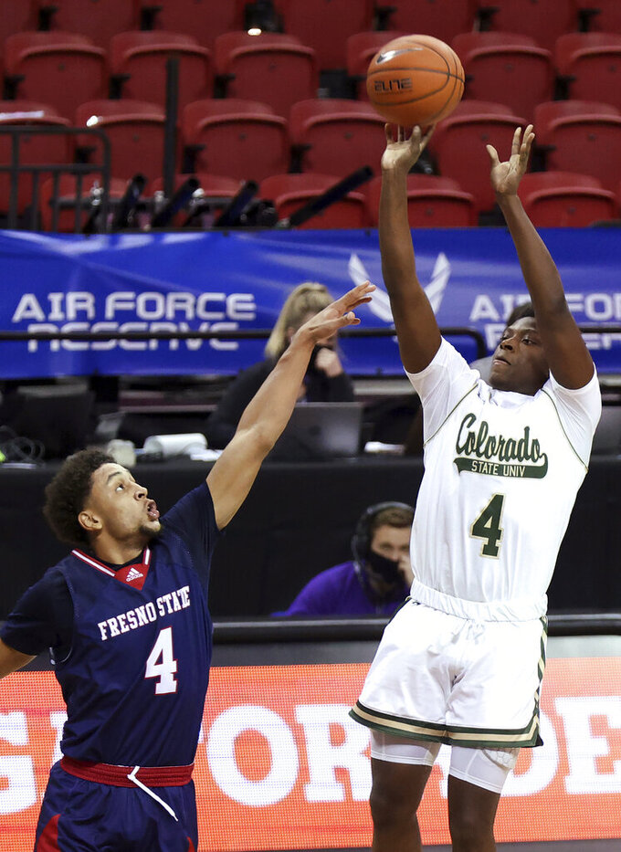 Colorado State guard Isaiah Stevens (4) shoots as Fresno State guard Junior Ballard (4) defends during the second half of an NCAA college basketball game in the quarterfinals of the Mountain West Conference men's tournament Thursday, March 11, 2021, in Las Vegas. (AP Photo/Isaac Brekken)