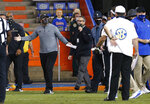 Missouri coach Eliah Drinkwitz gestures toward Florida coach Dan Mullen, obscured at right, after a fight broke out at the end of the first half of an NCAA college football game in Gainesville, Fla., Saturday, Oct. 31, 2020. (Brad McClenny/The Gainesville Sun via AP)