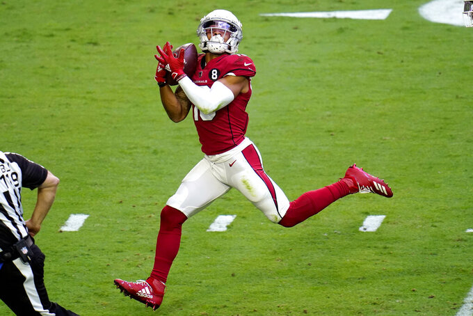 Arizona Cardinals wide receiver Christian Kirk pulls in a touchdown pass against the Miami Dolphins during the first half of an NFL football game, Sunday, Nov. 8, 2020, in Glendale, Ariz. (AP Photo/Ross D. Franklin)