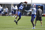 Buffalo Bills cornerback Tre'Davious White (27) intercepts the ball in front of wide receiver Stefon Diggs (14) during an NFL football training camp in Orchard Park, N.Y., Monday, Aug. 31, 2020. (James P. McCoy/Buffalo News via AP, Pool)