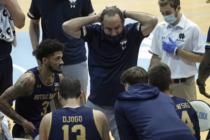 Notre Dame head coach Mike Brey speaks with his team during the second half of an NCAA college basketball game against North Carolina in Chapel Hill, N.C., Saturday, Jan. 2, 2021. (AP Photo/Gerry Broome)