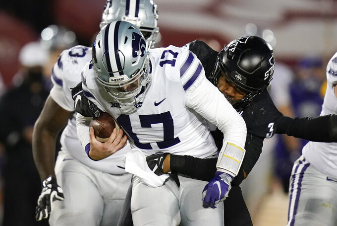 Kansas State quarterback Nick Ast (17) is sacked by Iowa State defensive end JaQuan Bailey (3) during the second half of an NCAA college football game, Saturday, Nov. 21, 2020, in Ames, Iowa. Iowa State won 45-0. (AP Photo/Charlie Neibergall)