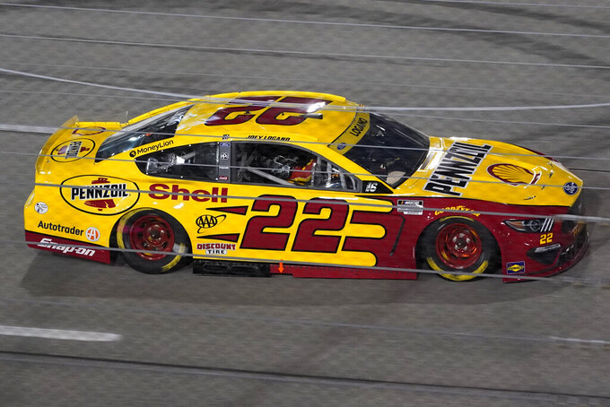Joey Logano heads into Turn 1 during the NASCAR Cup series auto race in Richmond, Va., Saturday, Sept. 11, 2021. (AP Photo/Steve Helber)