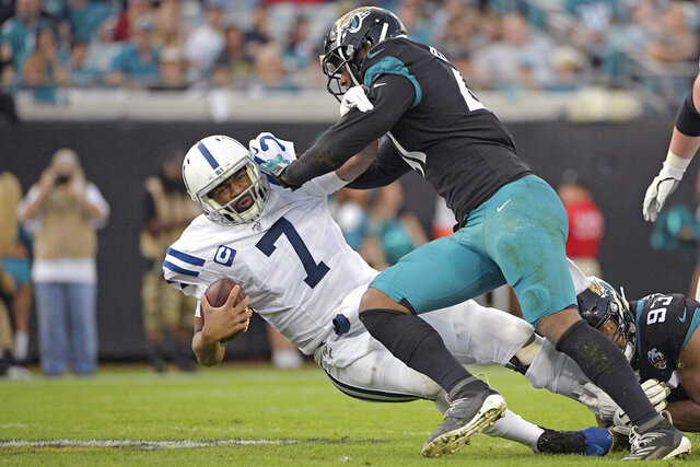Jacksonville Jaguars linebacker Josh Allen, right, sacks Indianapolis Colts quarterback Jacoby Brissett (7) during the first half of an NFL football game, Sunday, Dec. 29, 2019, in Jacksonville, Fla. (AP Photo/Phelan M. Ebenhack)