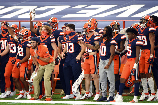 The Syracuse bench reacts during an NCAA college football game against Georgia Tech, Saturday, Sept. 26, 2020, at the Carrier Dome in Syracuse, N.Y. (Dennis Nett/The Post-Standard via AP)