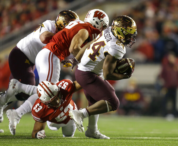 Minnesota running back Mohamed Ibrahim (24) runs against Wisconsin linebacker T.J. Edwards (53) during the second half of an NCAA college football game Saturday, Nov. 24, 2018, in Madison, Wis. Minnesota won 37-15. (AP Photo/Andy Manis)
