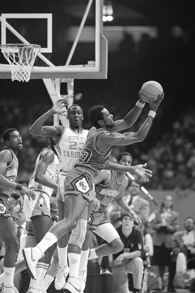FILE - In this March 29, 2020, file photo, Georgetown's Ed Springs takes a rebound away from North Carolina's Michael Jordan (23) during the NCAA championship at the Superdome in New Orleans. Jordan scored 16 points, including the game-winning shot with 15 seconds left. North Carolina beat Georgetown 63-62. (AP Photo/File)