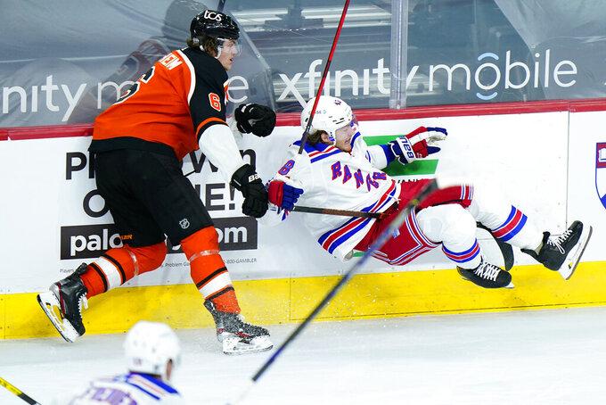 Philadelphia Flyers' Travis Sanheim (6) and New York Rangers' Brendan Lemieux (48) collide during the third period of an NHL hockey game, Wednesday, Feb. 24, 2021, in Philadelphia. (AP Photo/Matt Slocum)