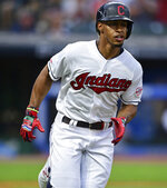 Cleveland Indians' Francisco Lindor runs after hitting a two-run double during the second inning of the team's baseball game against the Detroit Tigers, Tuesday, July 16, 2019, in Cleveland. (AP Photo/David Dermer)