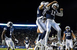 BYU quarterback Zach Wilson (11) and wide receiver Neil Pau'u (84) celebrate following Wilson's touchdown against Hawaii during an NCAA college football game Saturday, Oct. 13, in Provo, Utah. (Isaac Hale/Daily Herald via AP)