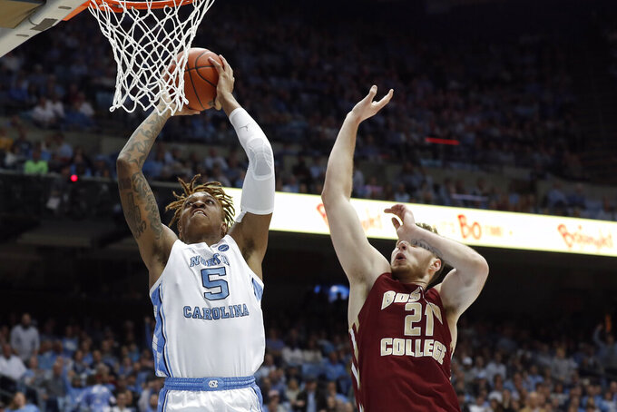 North Carolina forward Armando Bacot (5) shoots while Boston College forward Nik Popovic (21) defends during the first half of an NCAA college basketball game in Chapel Hill, N.C., Saturday, Feb. 1, 2020. (AP Photo/Gerry Broome)