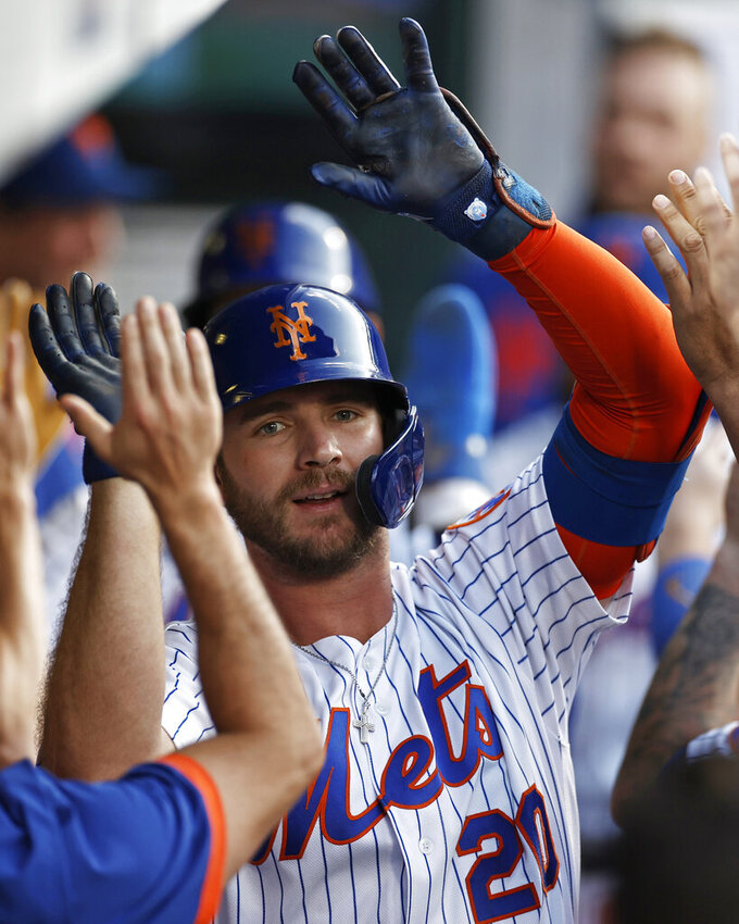 New York Mets' Pete Alonso is congratulated for his two-run home run against the Toronto Blue Jays during the first inning of a baseball game Friday, July 23, 2021, in New York. (AP Photo/Adam Hunger)