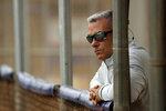 "FILE - In this Feb. 13, 2019, file photo, Kansas City Royals general manager Dayton Moore watches a workout during spring training baseball practice in Surprise, Ariz. For a number of rebuilding teams, the 2020 baseball season was supposed to be another step in the progression of their top prospects eventually reaching the big leagues. ""You want to be 100 percent sure a player is ready to help you at the major league level before you add them. There's no minor leagues to send them down to if they struggle at the major league level,"" Moore said.(AP Photo/Charlie Riedel, File)"
