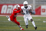 Utah State running back Gerold Bright (1) runs for yardage defended by New Mexico safety Johnny Hernandez (32) during the second half of an NCAA college football game on Saturday, Nov. 30, 2019 in Albuquerque, N.M. (AP Photo/Andres Leighton)