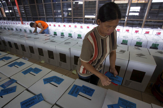 In this Monday, April 15, 2019 photo, Workers prepare ballot boxes for distribution ahead of April 17 elections in Medan, North Sumatra, Indonesia. Nearly 193 million Indonesians are eligible to vote in presidential and legislative elections on Wednesday. President Joko Widodo, the first Indonesian president from outside the Jakarta elite, is competing against Prabowo Subianto, a former special forces general from the era of authoritarian rule under military dictator Suharto. (AP Photo/Binsar Bakkara)