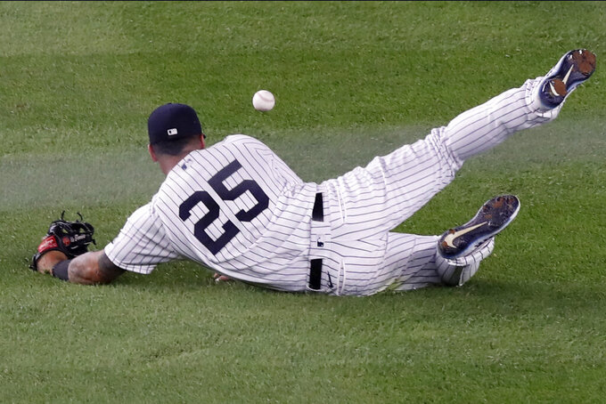 New York Yankees shortstop Gleyber Torres (25) drops Boston Red Sox's Christian Vazquez's fourth-inning single during a baseball game Monday, Aug. 17, 2020, in New York. (AP Photo/Kathy Willens)