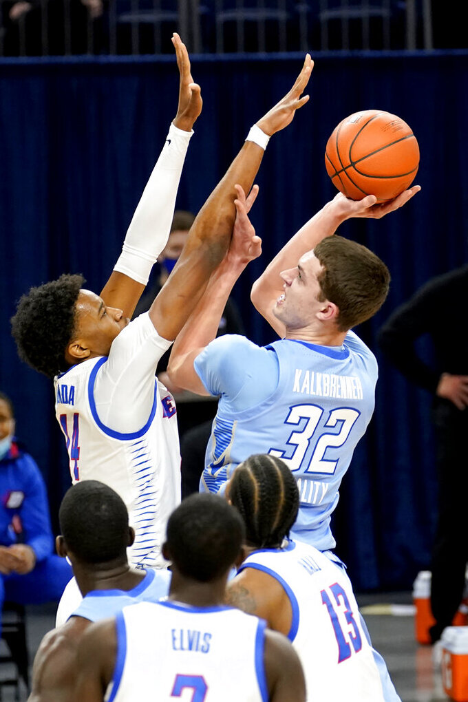 Creighton's Ryan Kalkbrenner (32) shoots over DePaul's Nick Ongenda during the first half of an NCAA college basketball game Saturday, Jan. 30, 2021, in Chicago. (AP Photo/Charles Rex Arbogast)