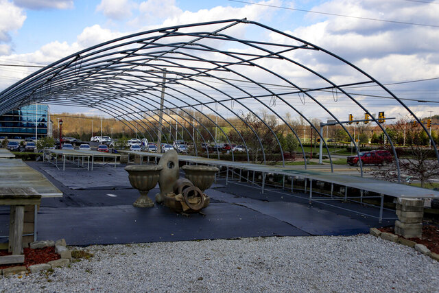 Empty tables for garden plants are under the framework for a greenhouse, Friday, April 24, 2020, in Cranberry Township. Some garden centers remain shuttered under Wolf's statewide March 19 order for