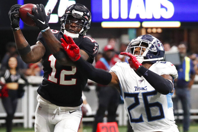 Atlanta Falcons wide receiver Mohamed Sanu (12) misses the catch against Tennessee Titans cornerback Logan Ryan (26) during the second half of an NFL football game, Sunday, Sept. 29, 2019, in Atlanta. (AP Photo/John Bazemore)