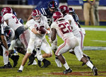 Alabama quarterback Mac Jones (10) hands off to running back Najee Harris (22) during the second half of the team's NCAA college football game against Mississippi in Oxford, Miss., Saturday, Oct. 10, 2020. Alabama won 63-48. (AP Photo/Rogelio V. Solis)