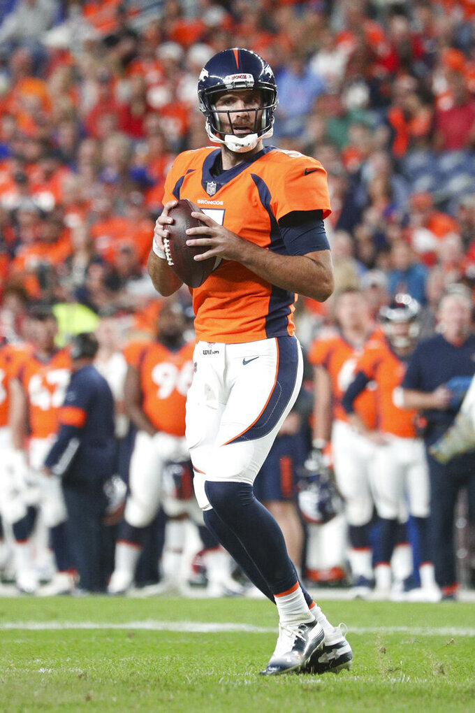 Denver Broncos quarterback Joe Flacco (5) looks downfield for a receiver in an NFL game against the Kansas City Chiefs, Thursday, Oct. 17, 2019, in Denver. The Chiefs defeated the Broncos 30-6. (Margaret Bowles via AP)