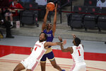 Alcorn State forward Tyree Corbett, top, grabs a rebound over Houston forward Justin Gorham (4) as Jamal Shead (1) watches during the first half of an NCAA college basketball game, Sunday, Dec. 20, 2020, in Houston. (AP Photo/Eric Christian Smith)