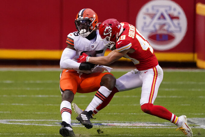 Cleveland Browns tight end David Njoku, left, is tackled by Kansas City Chiefs safety Daniel Sorensen, right, after catching a pass during the second half of an NFL divisional round football game, Sunday, Jan. 17, 2021, in Kansas City. (AP Photo/Charlie Riedel)