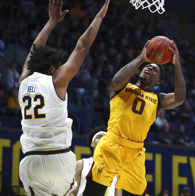 Arizona State guard Luguentz Dort, right, shoots against California's Andre Kelly (22) during the first half of an NCAA college basketball game Wednesday, Jan. 9, 2019, in Berkeley, Calif. (AP Photo/Ben Margot)