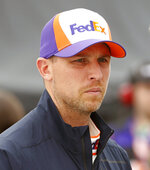 FILE - In this April 12, 2019, file photo, Denny Hamlin is shown prior to qualifying at Richmond International Raceway in Richmond, Va. Denny Hamlin suffered from nausea and double vision from carbon monoxide that seeped into his Toyota at the end of a NASCAR race at Dover, Del. Hamlin felt ill after Monday's, May 6, 2019, race and was attended to by medical staff on pit road after he finished 21st (AP Photo/Steve Helber, File)