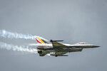 FILE - In this Wednesday, May 18, 2016 file photo, a Belgian F16 fighter jet flies over Florennes Military Airbase, in Florennes, Belgium. A Belgian F-16 fighter jet crashed Thursday, Sept. 19, 2019 on a road in western France and one of its pilots is hanging from a high-voltage electricity line after his parachute got caught, according to French authorities. (AP Photo/Geert Vanden Wijngaert, File)