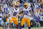 LSU running back Clyde Edwards-Helaire (22) celebrates his touchdown with tight end Thaddeus Moss (81) in the second half of an NCAA college football game against Auburn in Baton Rouge, La., Saturday, Oct. 26, 2019. LSU won 23-20. (AP Photo/Gerald Herbert)