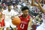 Louisville guard David Johnson (13) drives under the Florida State basket in the first half of an NCAA college basketball game in Tallahassee, Fla., Monday, Feb. 24, 2020. (AP Photo/Mark Wallheiser)