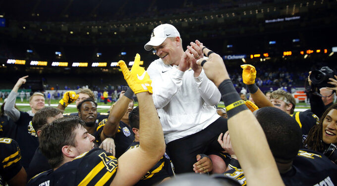 Appalachian State players hoist interim head coach Mark Ivey onto their shoulders after their victory over Middle Tennessee in the New Orleans Bowl NCAA college football game in New Orleans, Saturday, Dec. 15, 2018. Appalachian State won 45-13. (AP Photo/Gerald Herbert)