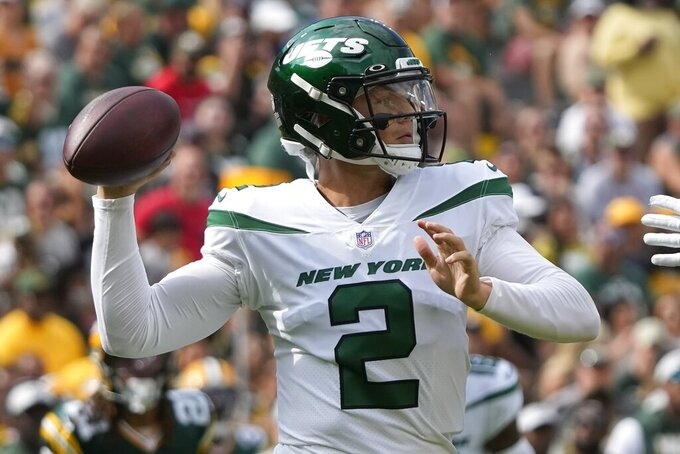 New York Jets' Zach Wilson throws during the first half of a preseason NFL football game against the Green Bay Packers Saturday, Aug. 21, 2021, in Green Bay, Wis. (AP Photo/Morry Gash)