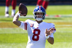 New York Giants quarterback Daniel Jones throws before an NFL football game against the Chicago Bears in Chicago, Sunday, Sept. 20, 2020. (AP Photo/Charles Rex Arbogast)