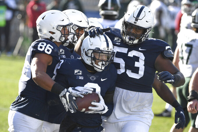 Penn State wide receiver Parker Washington (3) celebrates his touchdown reception against Michigan State during the third quarter pf an NCAA college football game in State College, Pa., on Saturday, Dec. 12, 2020. (AP Photo/Barry Reeger)