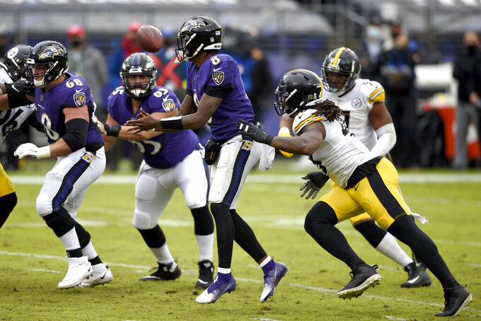 Pittsburgh Steelers outside linebacker Bud Dupree, front right, forces a fumble by Baltimore Ravens quarterback Lamar Jackson (8) during the first half of an NFL football game, Sunday, Nov. 1, 2020, in Baltimore. The Steelers recovered the fumble. (AP Photo/Gail Burton)