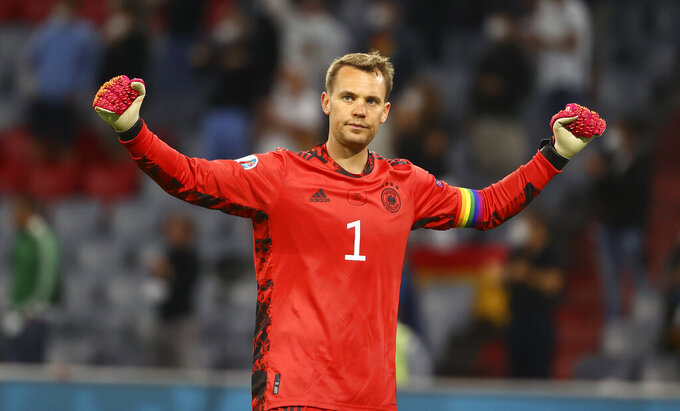 Germany's goalkeeper Manuel Neuer reacts after the Euro 2020 soccer championship group F match between Germany and Hungary in Munich, Wednesday, June 23, 2021.(Kai Pfaffenbach/Pool via AP)