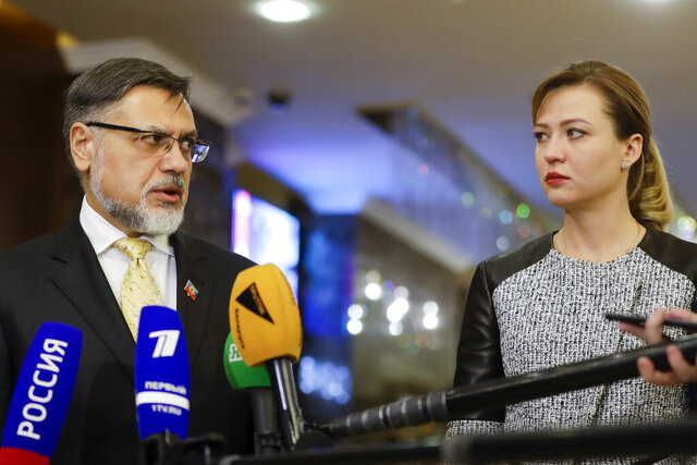 Natalia Nikonorova, a representative of Russia-backed rebels in Donetsk, right, and Vladislav Deinego, a representative of Russia-backed rebels in Luhanskleft, look at each other during a news conference after peace talks for Ukraine, in Minsk, Belarus, Wednesday, Dec. 18, 2019. Ukraine and Russia-backed separatist rebels have failed to reach agreement on a prisoner exchange during another round of talks on the conflict in eastern Ukraine. (AP Photo/Sergei Grits)