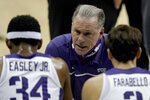TCU head coach Jamie Dixon talks to his players during the first half of an NCAA college basketball game against Liberty Sunday, Nov. 29, 2020, at the T-Mobile Center in Kansas City, Mo. (AP Photo/Charlie Riedel)