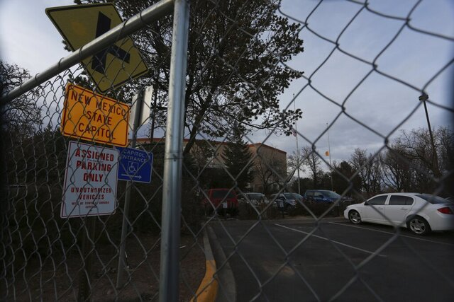Fencing blocks an entrance to the New Mexico State capitol building on Wednesday, Jan. 13, 2021, in Santa Fe, New Mexico. The barriers were erected following the Jan. 6 riot in Washington, D.C., after safety concerns for the upcoming legislative session. (AP Photo/Cedar Attanasio)
