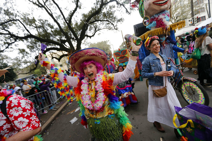 A member of the walking club Mondo Kayo revels as they march and dance down the route of the Krewe of Zulu parade on Mardi Gras day in New Orleans, Tuesday, Feb. 13, 2018. (AP Photo/Gerald Herbert)