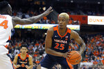 Virginia's Mamadi Diakite, right, under pressure from Syracuse's Bourama Sidibe, left, protects the ball during the first half of an NCAA college basketball game in Syracuse, N.Y., Wednesday, Nov. 6, 2019. (AP Photo/Nick Lisi)