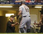 San Francisco Giants' Tyler Austin is congratulated by manager Bruce Bochy after hitting a home run during the eighth inning of a baseball game against the Milwaukee Brewers Friday, July 12, 2019, in Milwaukee. (AP Photo/Morry Gash)