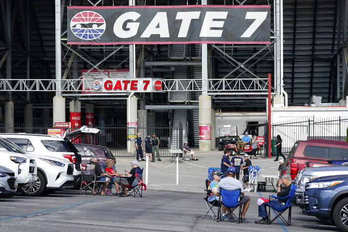 People wait to get into Bristol Motor Speedway for a NASCAR Xfinity Series auto race Friday, Sept. 17, 2021, in Bristol, Tenn. (AP Photo/Mark Humphrey)