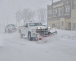 City of Scottsbluff, Neb. plows work to clear snow from Broadway on Wednesday, March 13, 2019. Evacuations forced by flooding have occurred in several eastern Nebraska communities, as western Nebraska residents struggled with blizzardlike conditions. (Spike Jordan/The Star-Herald via AP)