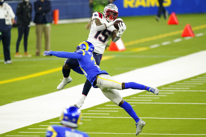 New England Patriots wide receiver N'Keal Harry (15) makes a catch over Los Angeles Rams defensive back Darious Williams during the second half of an NFL football game Thursday, Dec. 10, 2020, in Inglewood, Calif. (AP Photo/Ashley Landis)